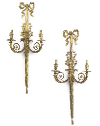 A SET OF THREE GILT-BRONZE TWI