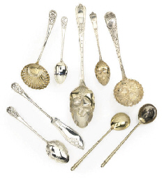 A NINE-PIECE PARCEL-GILT SILVE