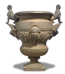 A FRENCH CAST-IRON URN