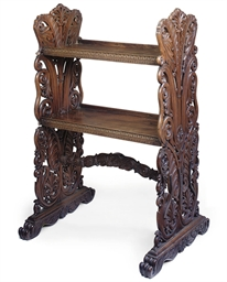 AN INDIAN CARVED TEAK TWO TIER