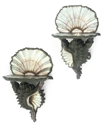 A PAIR OF VENETIAN SILVERED AN
