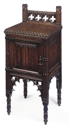 A MID VICTORIAN OAK GOTHIC BED