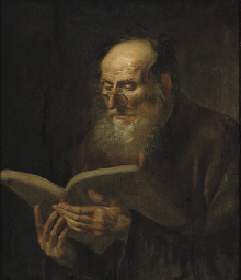 A bearded man reading