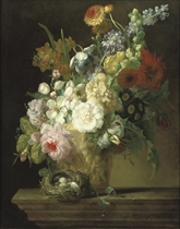 Roses, chrysanthemums, anemonies and other flowers in a sculpted vase with a bird's nest on a stone ledge