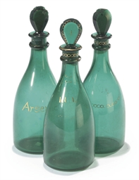 A SET OF THREE GREEN GLASS MAL