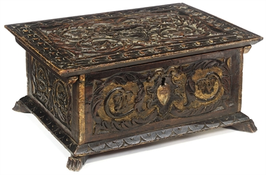 AN ITALIAN WALNUT CASKET