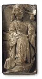 AN ALABASTER FRAGMENT OF A FEM