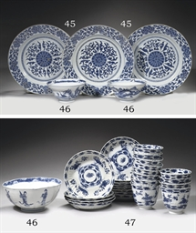 A set of three blue and white