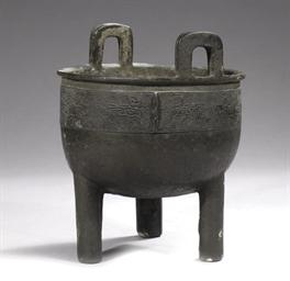 An archaistic bronze tripod fo