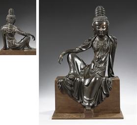 A rare chinese bronze figure o