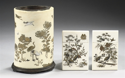 An ivory tusk vase and two car