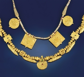 Two Indian gold cased necklace