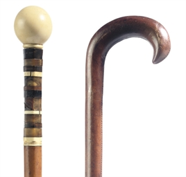 An Ivory and amber handled wal