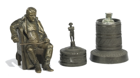 A bronze cylindrical reliquary