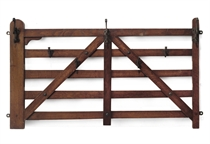A VICTORIAN OAK HANGING COAT RACK IN THE FORM OF A FIVE-BAR