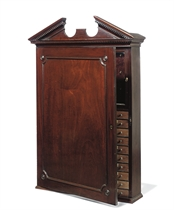 A GEORGE III MAHOGANY KEY AND COLLECTOR'S CABINET