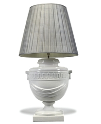 A WHITE-GLAZED POTTERY LAMP