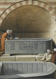 Figures in a tomb examining ba