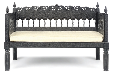 AN ANGLO-INDIAN EBONY SETTEE