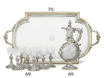 A FRENCH PARCEL-GILT SILVER TWO-HANDLED TRAY