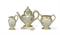 A VICTORIAN PARCEL-GILT SILVER BACHELOR TEA SERVICE**