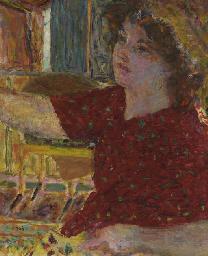 Jeune femme peignant