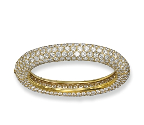 A DIAMOND BANGLE, BY CARTIER