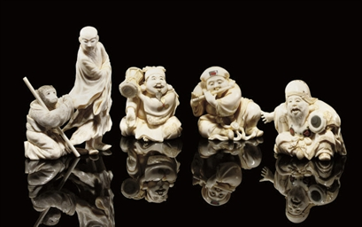 A group of eight ivory okimono
