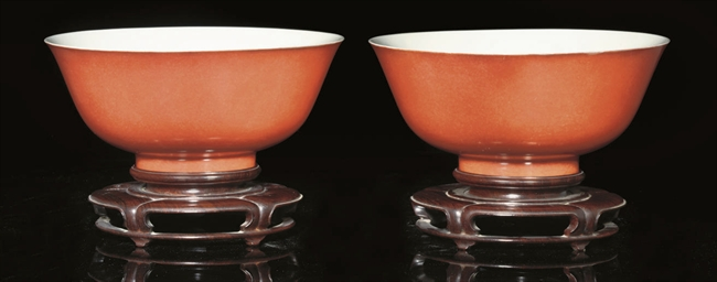 A pair of coral-glazed bowls,