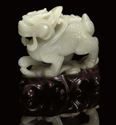 A WHITE JADE LARGE MODEL OF A