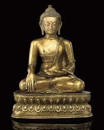A Tibetan gilt bronze model of