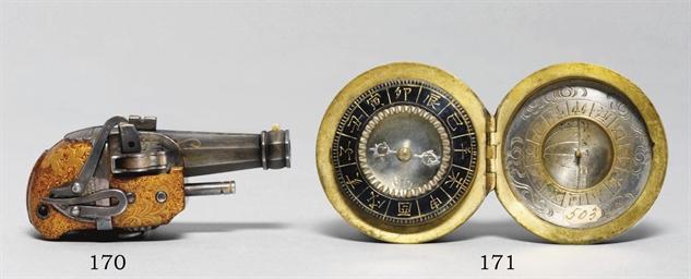 A silver manju compass