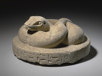 AN EGYPTIAN LIMESTONE SNAKE
