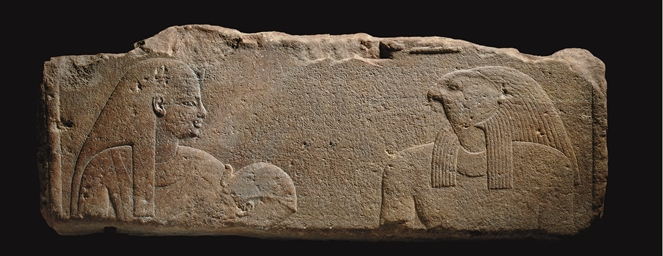 AN EGYPTIAN QUARTZITE RELIEF