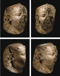 AN EGYPTIAN COLOSSAL QUARTZITE HEAD OF THE PHARAOH NECTANEBO II