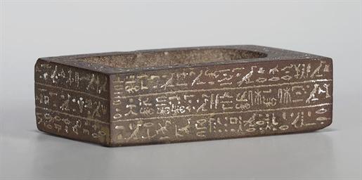 AN EGYPTIAN HEMATITE STATUE BA