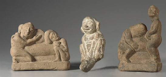 THREE EGYPTIAN TERRACOTTA EROT