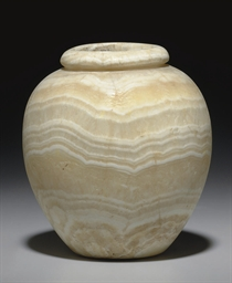 AN EGYPTIAN ALABASTER JAR