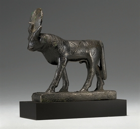 AN EGYPTIAN BRONZE APIS BULL