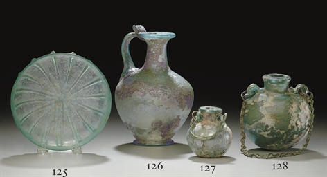 A ROMAN GLASS JUG