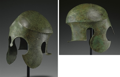 A GREEK BRONZE HELMET OF CHALC