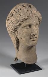A GREEK TERRACOTTA HEAD OF A G