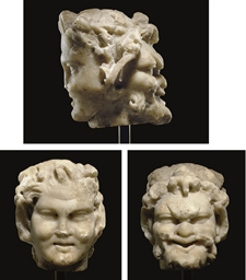A ROMAN MARBLE JANIFORM HEAD
