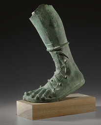 A ROMAN BRONZE LEFT LEG