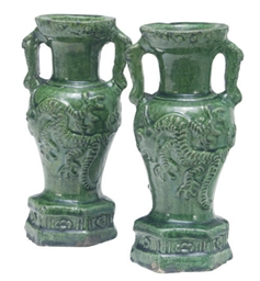 A PAIR OF MOLDED GREEN GLAZED