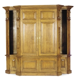 A CARVED OAK LIBRARY CABINET,