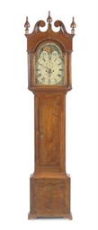 A GEORGE III WALNUT TALL-CASE