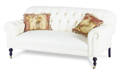 A BUTTON-TUFTED WHITE UPHOLSTE