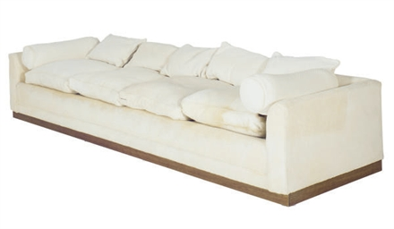 AN UPHOLSTERED FOUR-SEAT SOFA,