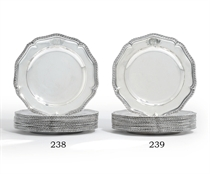 A SET OF TWELVE GEORGE II SILVER DINNER-PLATES